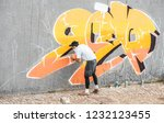 graffiti artist covering his... | Shutterstock . vector #1232123455
