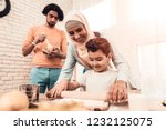 happy arabian family cooking... | Shutterstock . vector #1232125075