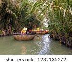 tourists riding bamboo basket... | Shutterstock . vector #1232135272