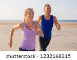 happy people running outdoors... | Shutterstock . vector #1232168215