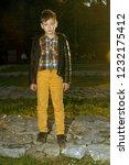 stylish boy standing in autumn... | Shutterstock . vector #1232175412