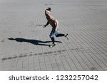 young athletic man with a naked ... | Shutterstock . vector #1232257042