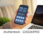female hand holding touch phone ... | Shutterstock . vector #1232265952