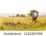 boys running in the meadow ... | Shutterstock . vector #1232287558