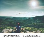 man is doing yoga pose on the... | Shutterstock . vector #1232318218