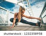 young female runner doing... | Shutterstock . vector #1232358958