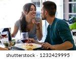 shot of beautiful young couple... | Shutterstock . vector #1232429995