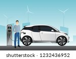 man charges an electric car at... | Shutterstock .eps vector #1232436952