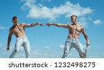 strong and powerful. men shows...   Shutterstock . vector #1232498275