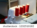 red thread spools on a white... | Shutterstock . vector #1232510182