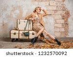 attractive stylish blonde woman ... | Shutterstock . vector #1232570092