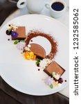 geometrical chocolate dessert... | Shutterstock . vector #1232585062