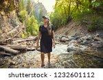 attractive woman hiking across... | Shutterstock . vector #1232601112