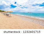 stegna beach with sunshades ... | Shutterstock . vector #1232601715