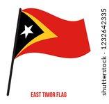 east timor flag waving vector... | Shutterstock .eps vector #1232642335