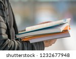 hands holding pile of books for ... | Shutterstock . vector #1232677948