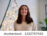 smiling woman in cosy home... | Shutterstock . vector #1232707432