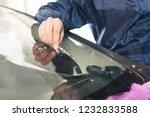 close up car glaze worker... | Shutterstock . vector #1232833588