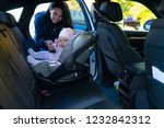 young mother standing next to... | Shutterstock . vector #1232842312