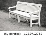 white wooden bench in park | Shutterstock . vector #1232912752