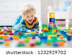 child playing with colorful toy ... | Shutterstock . vector #1232929702