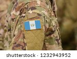 guatemala flag on soldiers arm. ... | Shutterstock . vector #1232943952