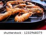 shrimp burnt in electric pan | Shutterstock . vector #1232968375