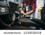 woman cleans car interior with... | Shutterstock . vector #1233028318