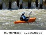 man kayaking in a waterway | Shutterstock . vector #1233028978