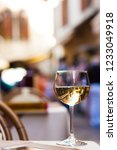 glass of chilled white wine on... | Shutterstock . vector #1233049918