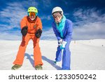 a couple on mountain vacation.... | Shutterstock . vector #1233050242