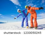a couple on mountain vacation.... | Shutterstock . vector #1233050245
