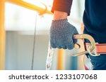 construction worker wearing... | Shutterstock . vector #1233107068