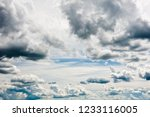 gray and white clouds in blue... | Shutterstock . vector #1233116005