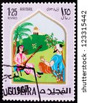 Small photo of FUJAIRAH - CIRCA 1967: A stamp printed in Fujairah shows the image of a singing woman from the story of Ali Baba , circa 1967.