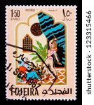 Small photo of FUJAIRAH - CIRCA 1967: A stamp printed in Fujairah shows the image of a dancing woman with a knife from the story of Ali Baba , circa 1967.