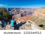 young woman sitting on the edge ... | Shutterstock . vector #1233164512