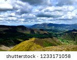 drak clouds moving over the... | Shutterstock . vector #1233171058