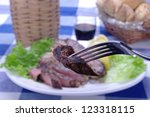fork with morsel of meat on a... | Shutterstock . vector #123318115