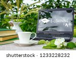 a cup with tea  a laptop  a... | Shutterstock . vector #1233228232