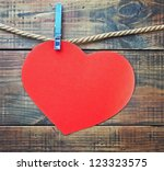 Red heart made of paper with a...