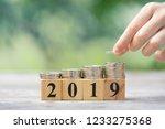 asian kid's hand putting coins... | Shutterstock . vector #1233275368