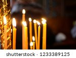 candles are burning  stand in... | Shutterstock . vector #1233389125