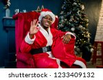 happy smiling african santa... | Shutterstock . vector #1233409132
