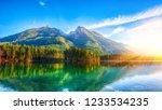 autumn sunset of hintersee lake.... | Shutterstock . vector #1233534235
