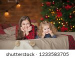 beautiful sisters on christmas... | Shutterstock . vector #1233583705