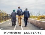 An Elderly Couple Walks In The...