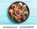 grilled chicken legs with...   Shutterstock . vector #1233658945