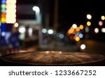 Stock photo selective empty wooden table in front of abstract blurred festive light background with light spots 1233667252