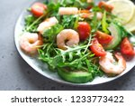 avocado shrimp arugula salad on ... | Shutterstock . vector #1233773422